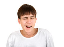 Tired Teenager yawning. Teenager Yawning Isolated on the White Background Royalty Free Stock Photography