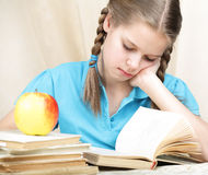 Tired ten years' schoolgirl Royalty Free Stock Image