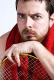 Tired tennis player with sweat over face Royalty Free Stock Image