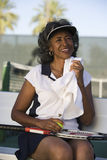 Tired Tennis Player Wiping Sweat With Napkin. Portrait of senior female tennis player wiping sweat with napkin Stock Images