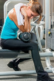 Tired thoughtful girl in the gym Royalty Free Stock Photography