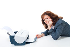 Tired to wait until printer print document. Woman tired to wait until printer print document, isolated on white Stock Image