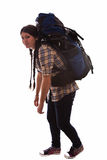 Tired tourist. Tired young tourist with a huge backpack Royalty Free Stock Photography