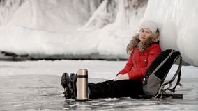 Tired tourist girl sitting on ice. stock footage