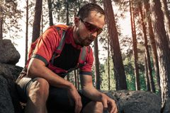 Tired trail running athlete stock photo