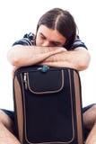 Tired traveler tourist man sleeping on luggage. Isolated on white background Royalty Free Stock Photos