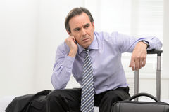 Tired of traveling. Portrait of a thoughtful senior businessman Royalty Free Stock Photos