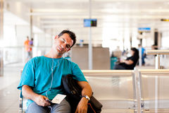 Tired traveller. Tired young male traveller sleeping in airport stock image