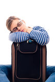 Tired traveller tourist woman sleeping on luggage Royalty Free Stock Photography
