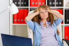 Tired unhappy business woman. Stock Photo