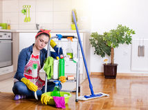Tired and unhappy cleaning lady Stock Photo