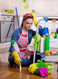 Tired and unhappy cleaning lady Royalty Free Stock Image