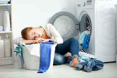 Tired unhappy woman housewife is engaged in the laundry, Stock Photography