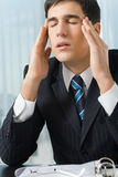 Tired or unhealthy businessman. At workplace royalty free stock photos