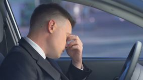Tired upset businessman sitting in car, pondering work problems, midlife crisis. Stock footage stock video