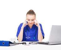 A tired and upset doctor working in the office Royalty Free Stock Images