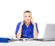 A tired and upset doctor working in the office Stock Photos