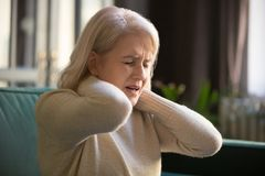 Free Tired Upset Old Senior Woman Feeling Stiff Neck Pain Concept Stock Photos - 156705833