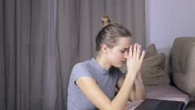 Tired and upset woman using her laptop at home. Tired and upset woman using her modern laptop at home stock footage