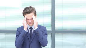 Tired Upset Young Businessman with Headache stock footage
