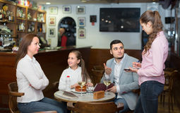 Tired waitress and displeased family Stock Photo
