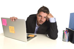 Tired wasted businessman working in stress at office laptop computer exhausted overwhelmed. Young tired and wasted businessman working in stress at office laptop Stock Images