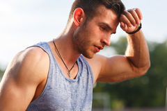 Free Tired Wet Athletic Man Wiping Sweat His Hand Royalty Free Stock Photos - 79254448