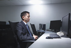 Tired White-collar worker sitting in office in front of computer Stock Image