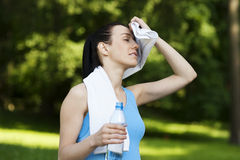 Tired woman. Sport collection: tired woman after jogging Royalty Free Stock Image