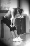 Tired Woman. Girl tired after hard exercises in the gym / Black and White with Blur and Light / Full Figure stock photo