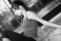 Tired Woman. Girl tired after hard exercises in the gym / Weary and Thinking / Lit Black White Lights Stock Photos