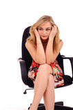 Tired woman in armchair Royalty Free Stock Images