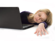 Tired woman asleep while using computer Royalty Free Stock Photography