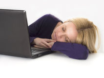 Tired woman asleep while using computer Royalty Free Stock Images