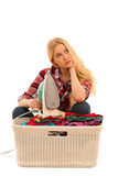 Tired woman with a basket of loundry annoyed with too much work Stock Photos