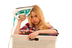 Tired woman with a basket of loundry annoyed with too much work Stock Images