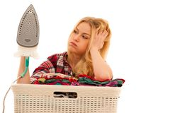 Tired woman with a basket of loundry annoyed with too much work.  Stock Image
