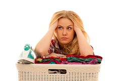 Tired woman with a basket of loundry annoyed with too much work.  Royalty Free Stock Images