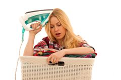 Tired woman with a basket of loundry annoyed with too much work isolated over white royalty free stock photo