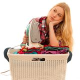 Tired woman with a basket of loundry annoyed with too much work.  Stock Photos