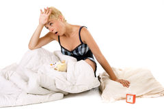 Tired woman in bed Stock Photography
