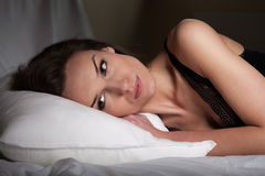 Tired woman in bed Stock Photo