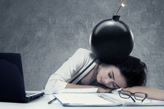 Tired woman with bomb Royalty Free Stock Images