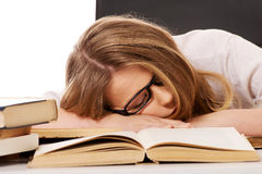 Tired woman with a books pile Royalty Free Stock Image
