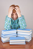 Tired woman and books Royalty Free Stock Image