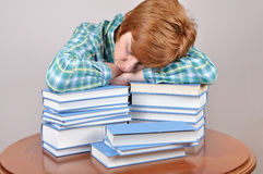 Tired woman and books Stock Images