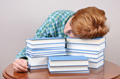 Tired woman and books Royalty Free Stock Images