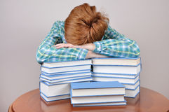 Tired woman and books Stock Photos
