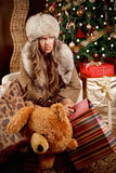 Tired woman with Christmas presents Royalty Free Stock Image