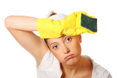 Tired woman cleaning Royalty Free Stock Images